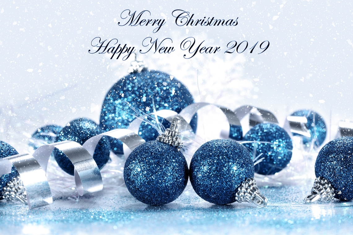 Merry Christmas and Happy New Year 2019 greeting with blue ornaments silver ribbon and glitters background Shutterstock ID 1264514227
