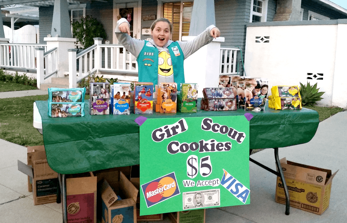 Girl Scout Malia hosts a neighborhood cookie stand