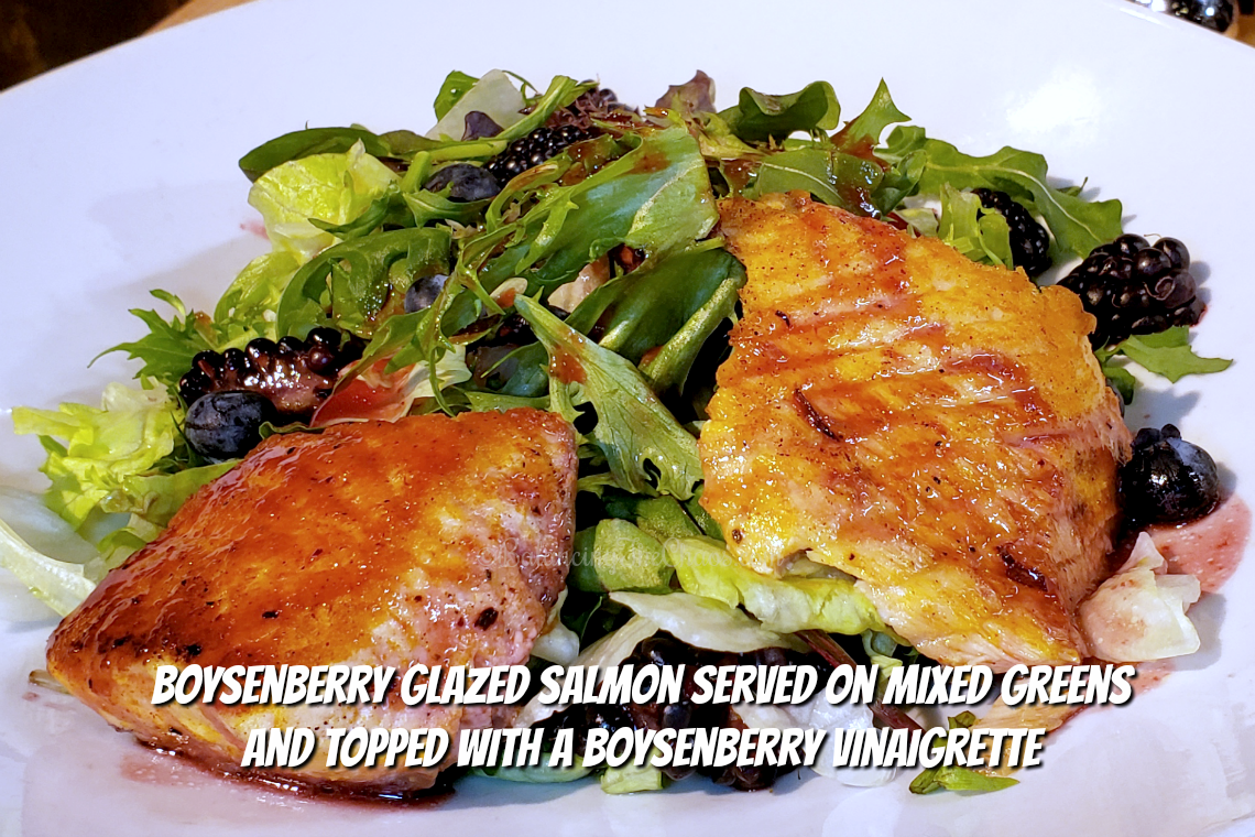 Boysenberry glazed salmon served on mixed greens and topped with a boysenberry vinaigrette