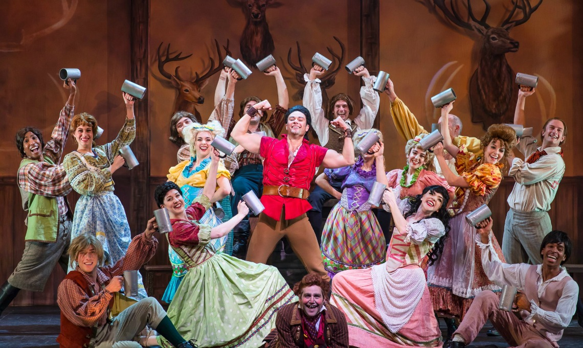 "Matthew Ragas (canter) stars as ""Gaston"" (Center) with the company of the La MIrada Theatre for the Performing Arts/McCoy Rigby Entertainment production of Disney's ""BEAUTY AND THE BEAST,"" directed by Michael Heitzman and now playing at La Mirada Theatre for the Performing Arts."