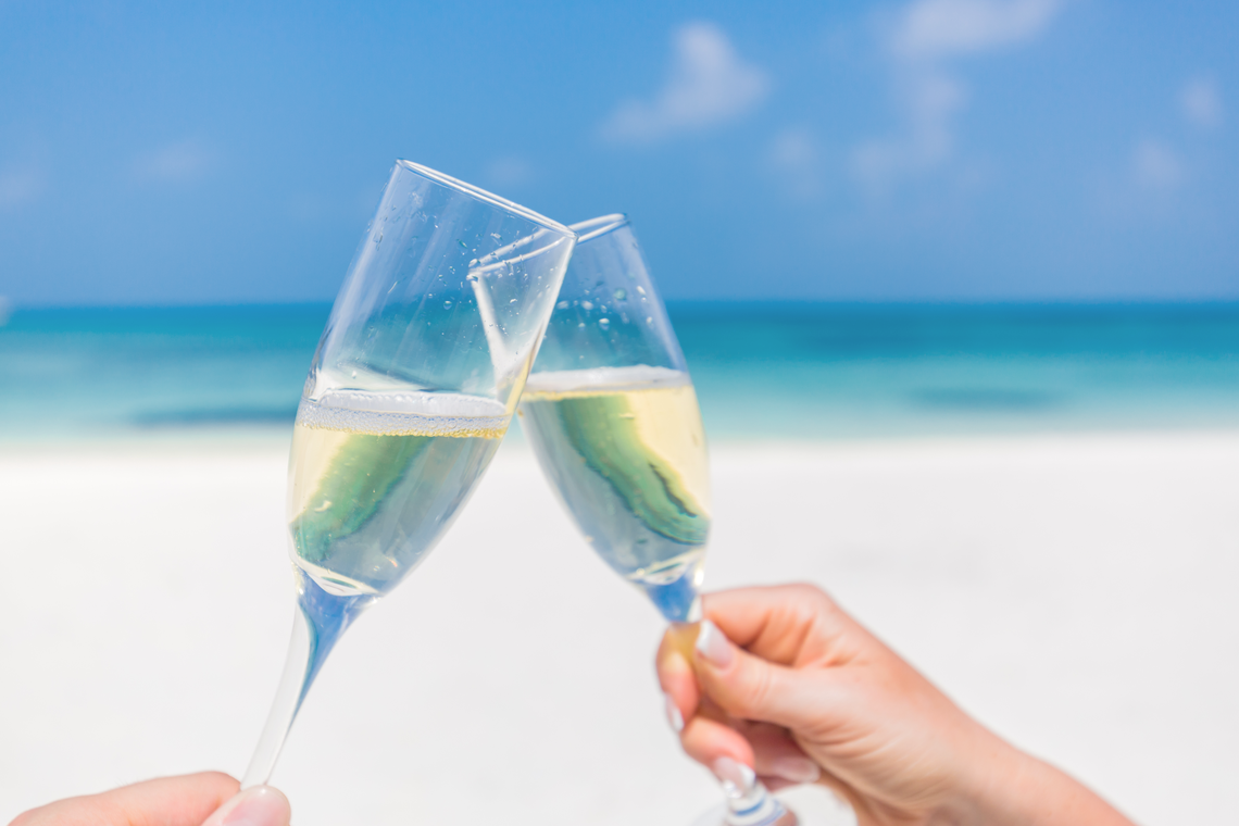 Enjoying champagne while on honeymoon at beaches all inclusive resort